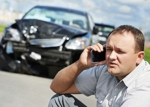Man calling infront car accident